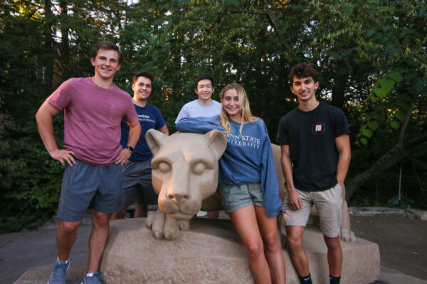 AIPR team members pose at the Lion Shrine